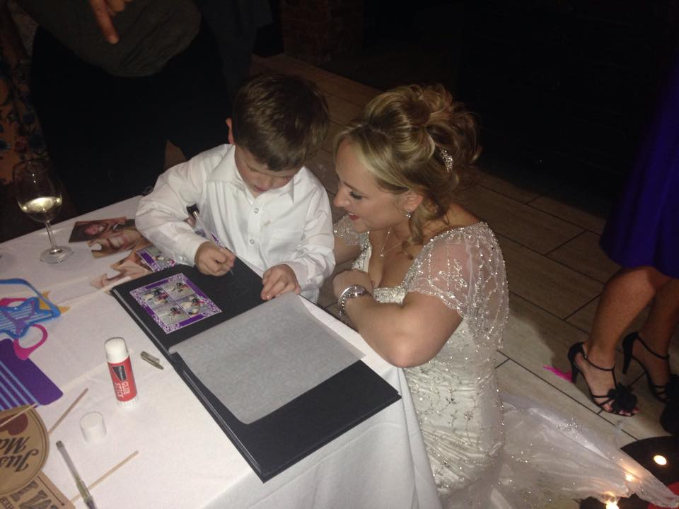 image shows a guest using a photo booth guest book