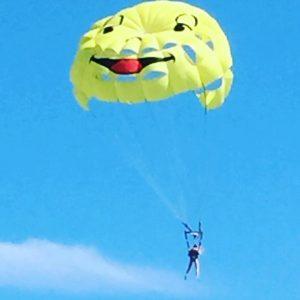 a smiley face parachute over the Mediterranean