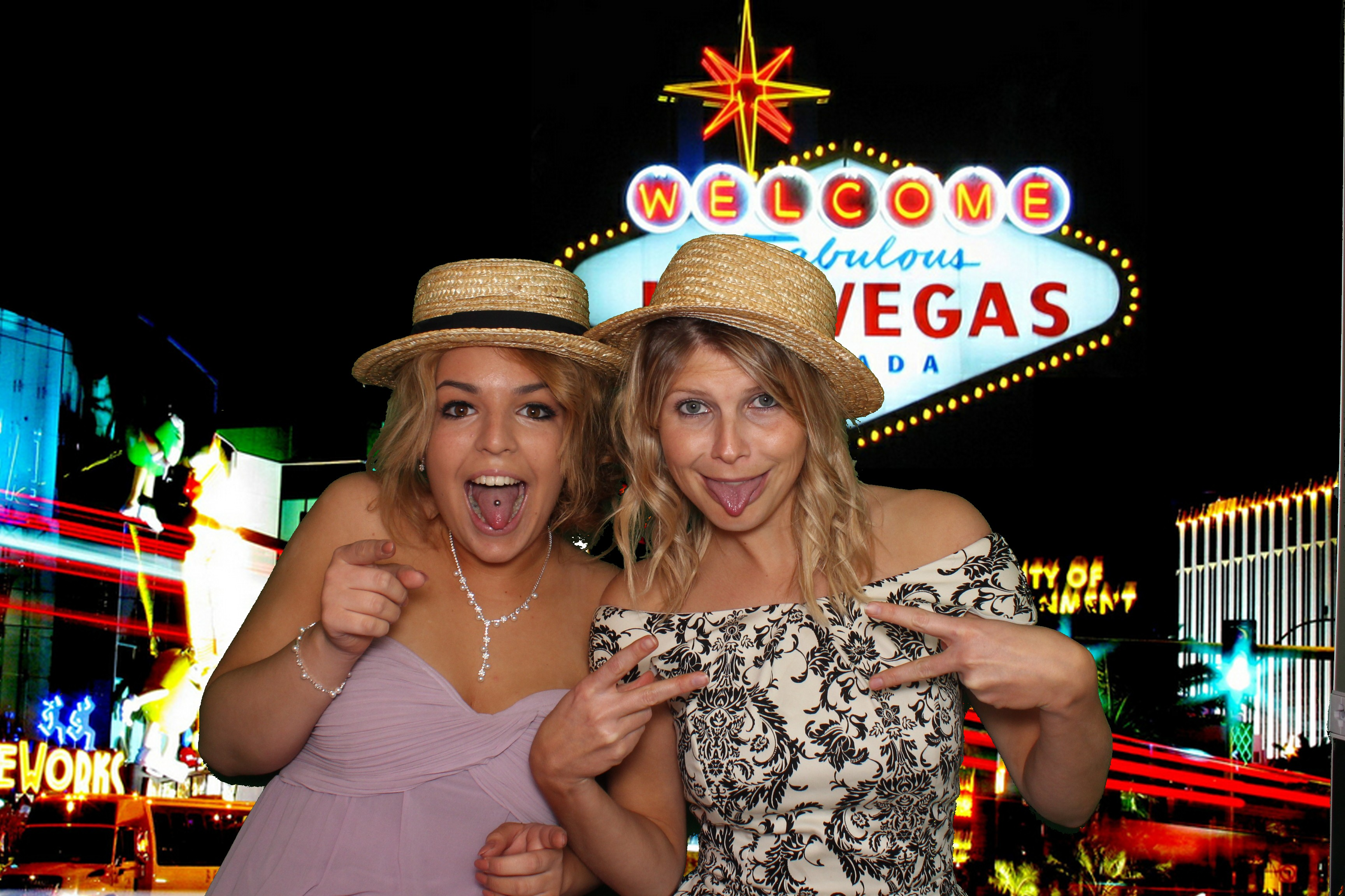 images shows two women in front of a greenscreen generated photo booth background
